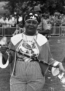 1981: Mrs Dorris Blackman at the Leeds West Indian Carnival in Potternewton Park, Leeds, prepares to play 'mas' on the road.